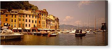 Boats In A Canal, Portofino, Italy Canvas Print by Panoramic Images