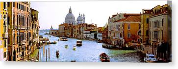 Boats In A Canal With A Church Canvas Print