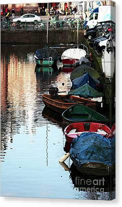 Boats In The Red Light District Canvas Print by John Rizzuto
