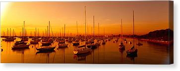 Boats Moored At A Harbor At Dusk Canvas Print by Panoramic Images