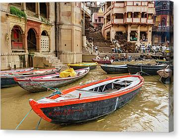 Boats On River Ganges, Varanasi, India Canvas Print by Ali Kabas