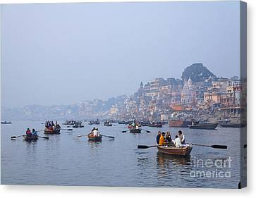 Ganges Canvas Print - Boats On The River Ganges At Varanasi In India by Robert Preston