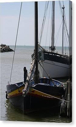 Boats Resting Canvas Print by Phoenix De Vries