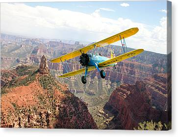 Boeing Stearman At Mount Hayden Grand Canyon Canvas Print by Gary Eason