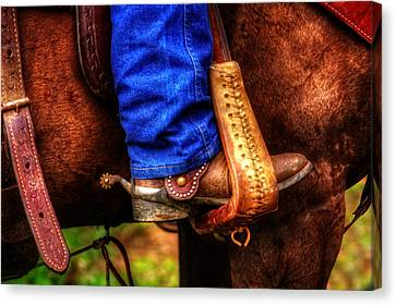 Boot And Saddle Canvas Print by Greg Mimbs