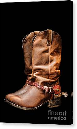 Boots On Black Canvas Print by Olivier Le Queinec
