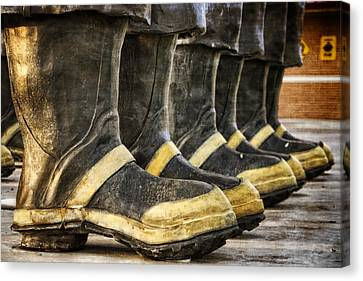 Boots On The Ground Canvas Print by Joan Carroll