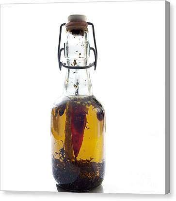Bottle Of Oil Canvas Print by Bernard Jaubert