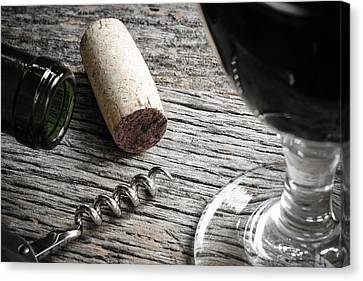 Bottle Of Red Wine With Cork Corkscrew And Glass Of Red Wine Canvas Print by Brandon Bourdages