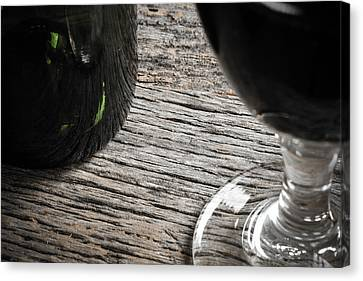 Bottle Of Wine And Glass Of Red Wine On Rustic Table Canvas Print by Brandon Bourdages
