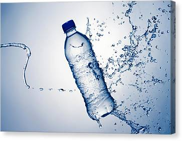 Bottle Water And Splash Canvas Print by Johan Swanepoel
