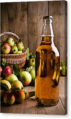 Bottled Cider With Apples Canvas Print by Amanda Elwell