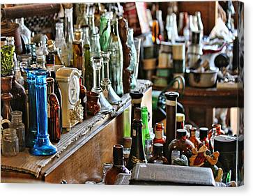 Bottles In The Old Stuff Shop Canvas Print by Lynn Jordan