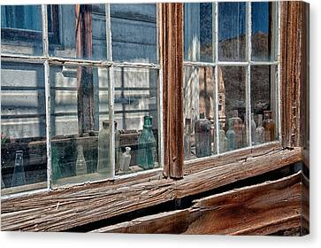 Bottles In The Window Canvas Print by Cat Connor