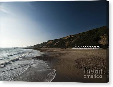 Bournemouth Beach Huts Canvas Print by Anne Gilbert