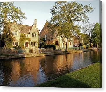 Bourton On The Water Canvas Print by Ron Harpham