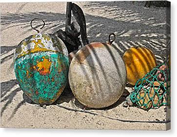 Bouys On The Beach Canvas Print by Kurt Gustafson