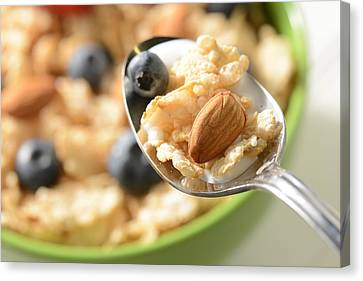 Bowl Of Cereal With Bluberries And Almonds On Spoon Canvas Print by Brandon Bourdages