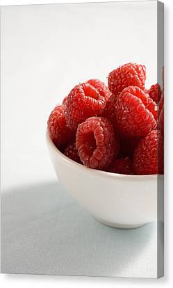 Bowl Of Raspberries Canvas Print by Greg Huszar Photography