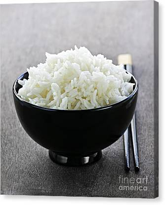 Bowl Of Rice With Chopsticks Canvas Print by Elena Elisseeva