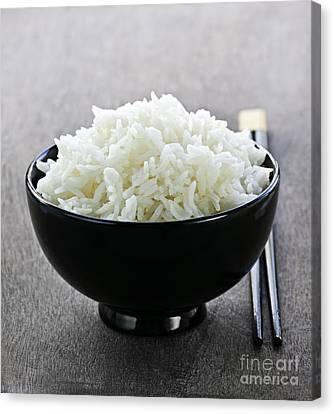 Bowl Of Rice With Chopsticks Canvas Print by Elena Elisseeva