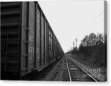 Box Cars And Tracks Canvas Print by Russell Christie