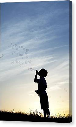 Boy Blowing Bubbles Canvas Print by Tim Gainey