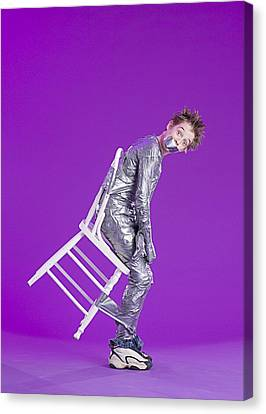 Boy Bound By Duct Tape Canvas Print by Ron Nickel