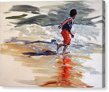 Boy Chases Waves On Beach Canvas Print
