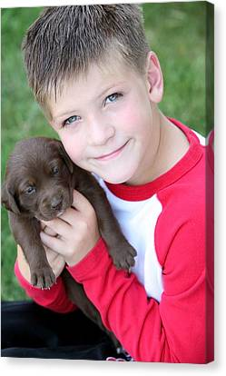 Boy Holding Puppy Canvas Print by Colleen Cahill