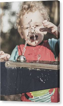 Real Experiences Canvas Print - Boy Mesmerised By The Element Of Water In Motion by Jorgo Photography - Wall Art Gallery