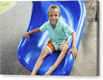 Boy On Slide Canvas Print by Kicka Witte