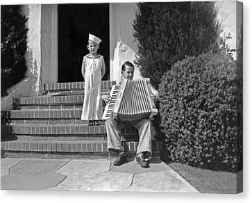 Boy Playing Accordian On Steps Canvas Print by Underwood Archives