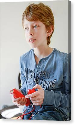 Boy Playing Wii Video Game Canvas Print by Aj Photo