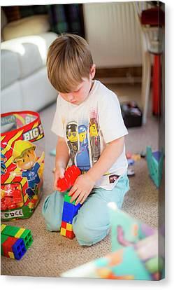 Boy Playing With Plastic Bricks Canvas Print