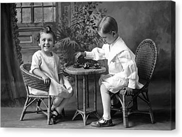 Boy Pours Sister A Cup Of Tea Canvas Print by Underwood Archives