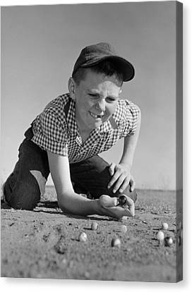 Boy Shooting Marbles, C.1950-60s Canvas Print by B. Taylor/ClassicStock