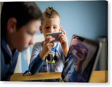 Boy Using Smartphone Canvas Print