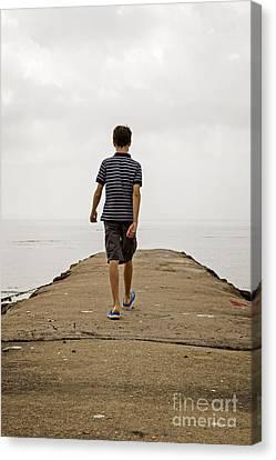 Boy Walking On Concrete Beach Pier Canvas Print by Edward Fielding