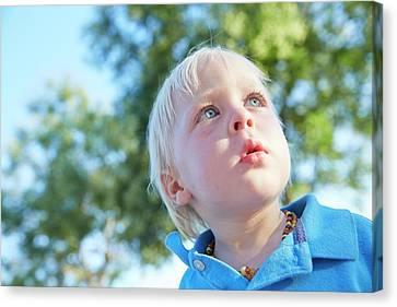 Boy With Blonde Hair Looking Away Canvas Print