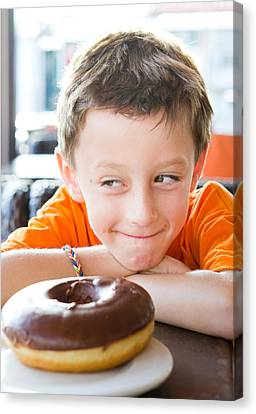 Boy With Donut Canvas Print by Tom Gowanlock