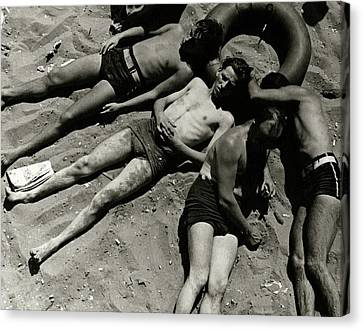 Boys Lying On The Beach At Coney Island In New Canvas Print