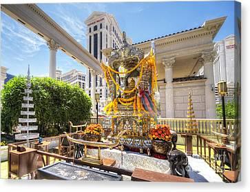 Brahma Shrine At Caesars Canvas Print by Yhun Suarez