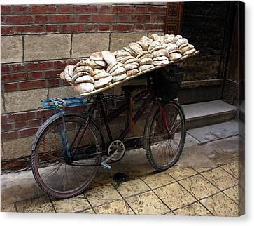 Canvas Print featuring the photograph Bread To Go In Cairo by Jacqueline M Lewis