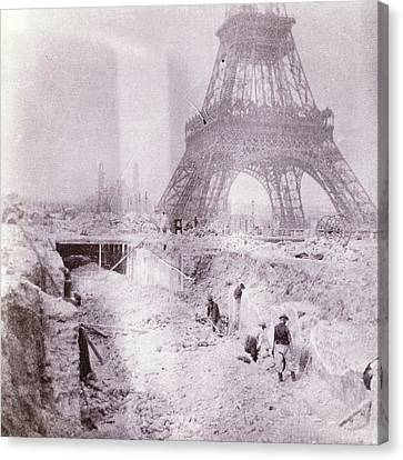 Breaking And Building Next To The Eiffel Tower Canvas Print