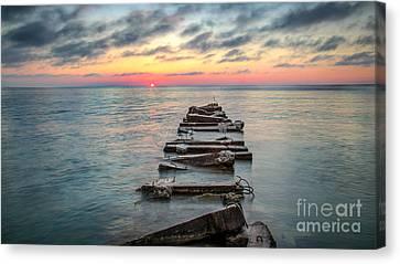 Breakwater Sunrise Canvas Print by Andrew Slater