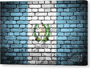 Brick Wall With Painted Flag Of Guatemala Canvas Print by Aleksandar Mijatovic