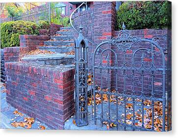 Canvas Print featuring the photograph Brick Wall With Wrought Iron Gate by Janette Boyd
