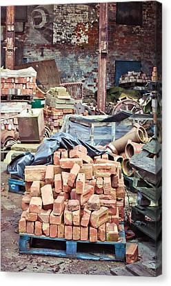 Bricks In Scrap Yard Canvas Print by Tom Gowanlock