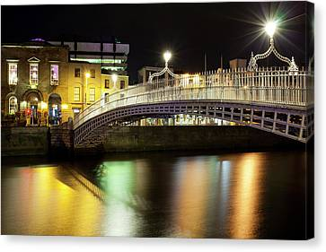 Dublin Building Colors Canvas Print - Bridge Across A River At Night, Hapenny by Panoramic Images